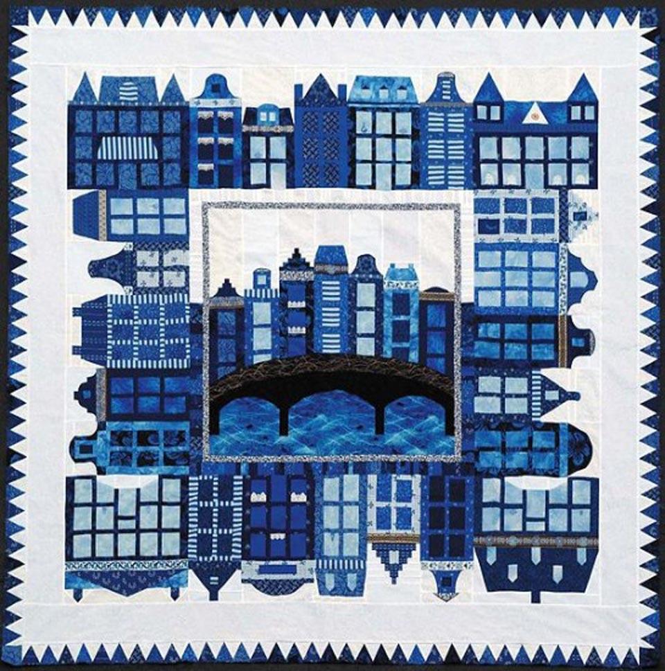 Representación-de-la-ciudad-de-Amsterdam-mediante-un-trabajo-de-patchwork.-545x550